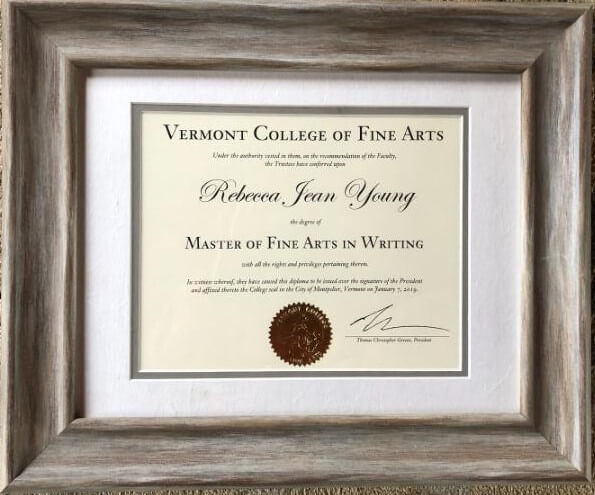 "Framed degree with seal and signature at bottom; prominent text is ""Vermont College of Fine Arts; Rebecca Jean Young; Master of Fine Arts in Writing"""
